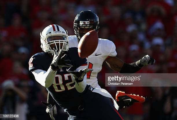 Wide receiver Juron Criner of the Arizona Wildcats catches a 45 yard touchdown reception past James Dockery of the Oregon State Beavers during the...