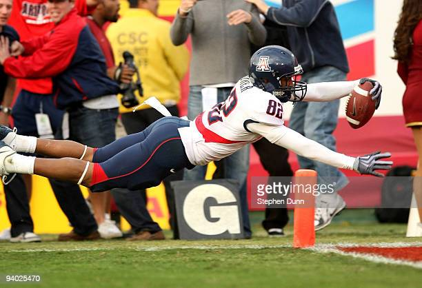 Wide receiver Juron Criner of the Arizona Wildcats dives into the end zone with a 36 yard catch for the winning touchdown in the fourth quarter...