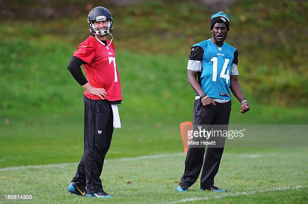 Wide receiver Justin Blackmon of Jacksonville Jaguars and quarter back Chad Henne take part in a training session at Pennyhill Park Hotel ahead of...