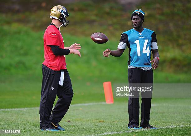 Wide receiver Justin Blackmon of Jacksonville Jaguars passes the ball to quarter back Chad Henne during a training session at Pennyhill Park Hotel...