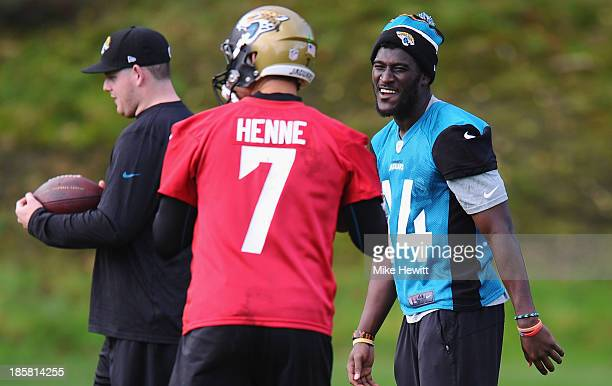 Wide receiver Justin Blackmon of Jacksonville Jaguars shares a joke with quarter back Chad Henne during a training session at Pennyhill Park Hotel...