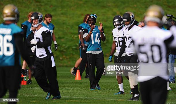 Wide receiver Justin Blackmon of Jacksonville Jaguars shouts encouragement during a training session at Pennyhill Park Hotel ahead of Sunday's NFL...