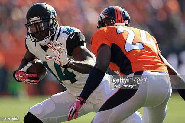 Wide receiver Justin Blackmon of the Jacksonville Jaguars makes a reception as cornerback Champ Bailey of the Denver Broncos makes the tackle at...