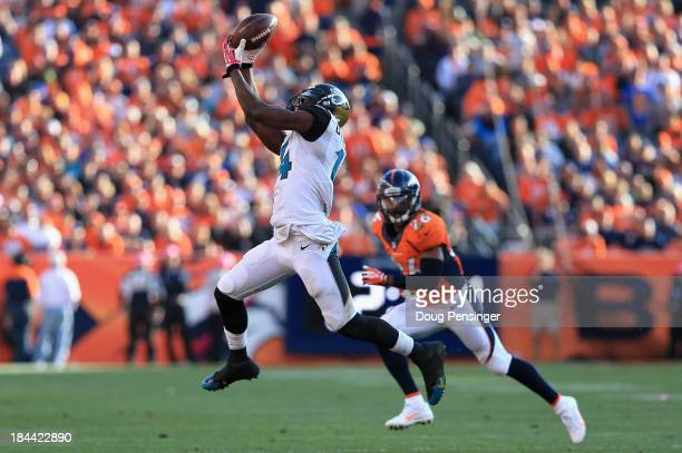 Wide receiver Justin Blackmon of the Jacksonville Jaguars makes a first down pass reception as free safety Rahim Moore of the Denver Broncos defends...