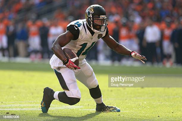 Wide receiver Justin Blackmon of the Jacksonville Jaguars makes a pass reception against the Denver Broncos at Sports Authority Field at Mile High on...