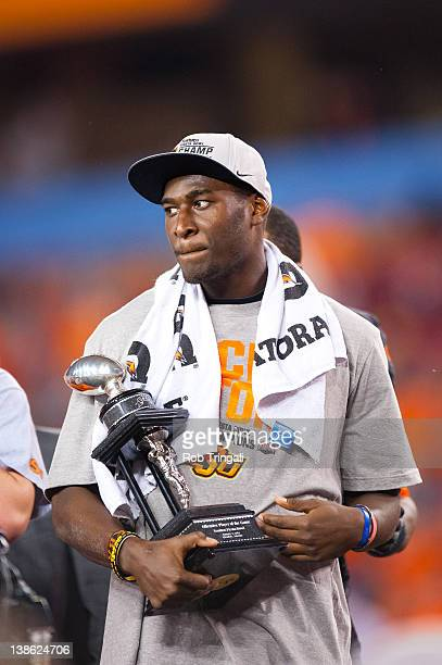 Wide receiver Justin Blackmon of the Oklahoma State Cowboys looks on with the Offensive Player of the Game Trophy after the game against the Stanford...