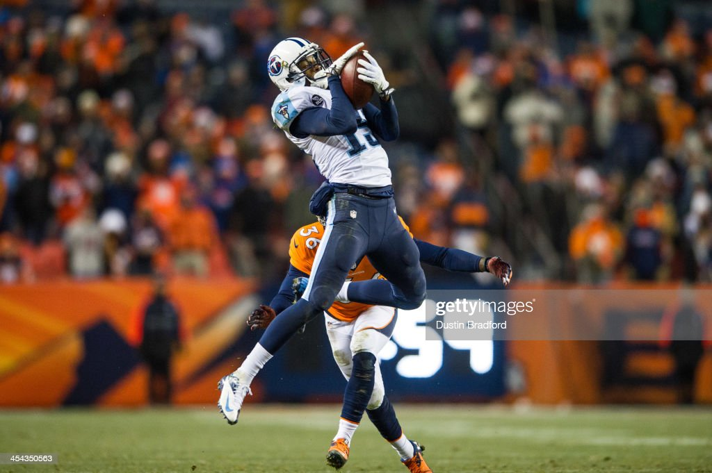 Wide receiver Justin Hunter #15 of the Tennessee Titans has a fourth quarter catch but is quickly tackled by cornerback Kayvon Webster #36 of the Denver Broncos during a game at Sports Authority Field Field at Mile High on December 8, 2013 in Denver, Colorado.