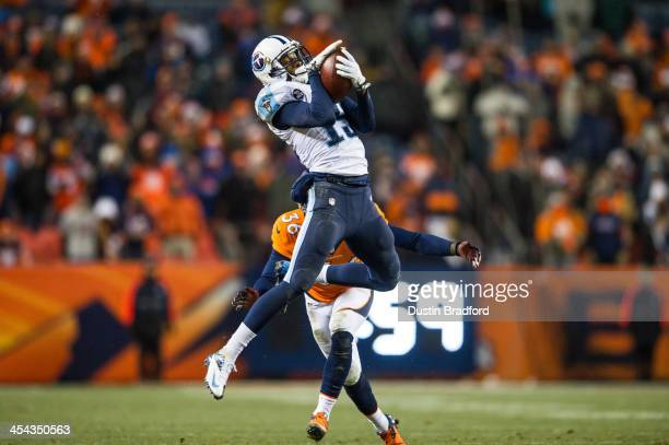 Wide receiver Justin Hunter of the Tennessee Titans has a fourth quarter catch but is quickly tackled by cornerback Kayvon Webster of the Denver...
