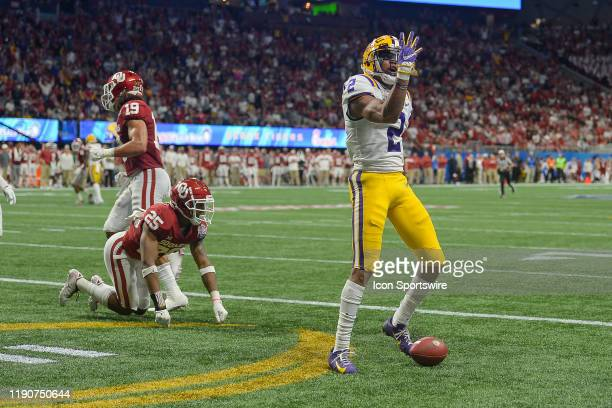 LSU wide receiver Justin Jefferson gestures after scoring his third touchdown of the firsthalf during the College Football Playoff Semifinal game...