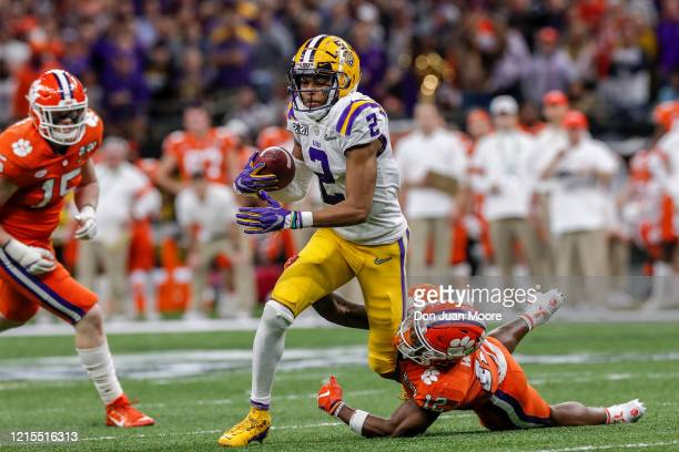 Wide Receiver Justin Jefferson of the LSU Tigers avoids a tackle by Safety K'Von Wallace of the Clemson Tigers during the College Football Playoff...