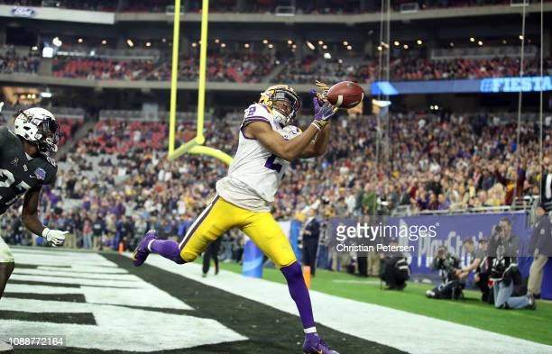 Wide receiver Justin Jefferson of the LSU Tigers can't hang on to a pass during the fourth quarter of the PlayStation Fiesta Bowl between LSU and...