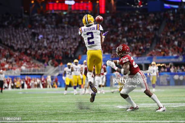 Wide receiver Justin Jefferson of the LSU Tigers catches for a touchdown in the second quarter against safety Justin Broiles of the Oklahoma Sooners...