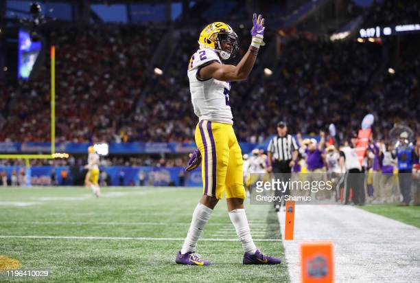 Wide receiver Justin Jefferson of the LSU Tigers celebrates his fourth touchdown in the second quarter against the Oklahoma Sooners during the...