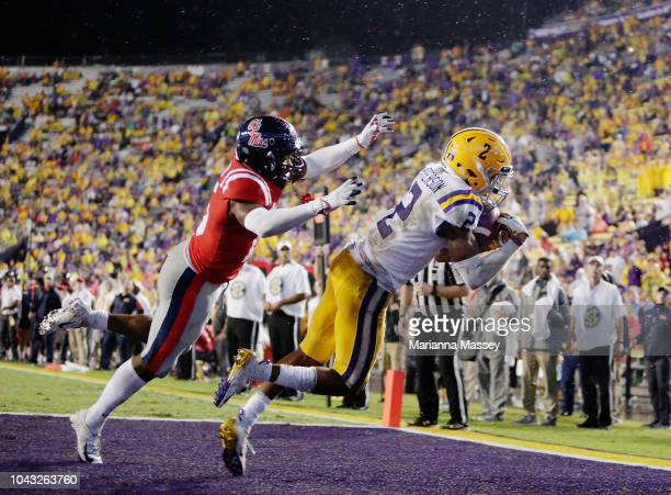 Wide receiver Justin Jefferson of the LSU Tigers makes a touchdown as defensive back Myles Hartsfield of the Mississippi Rebels trys to defend during...