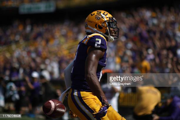 Wide receiver Justin Jefferson of the LSU Tigers reacts after scoring a touchdown against the Utah State Aggies at Tiger Stadium on October 05 2019...