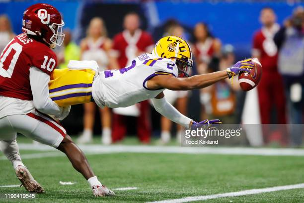 Wide receiver Justin Jefferson of the LSU Tigers score a touchdown in the first quarter over the Oklahoma Sooners in the ChickfilA Peach Bowl at...