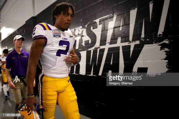 Wide receiver Justin Jefferson of the LSU Tigers walks out of the tunnel to take on the Oklahoma Sooners in the ChickfilA Peach Bowl at MercedesBenz...
