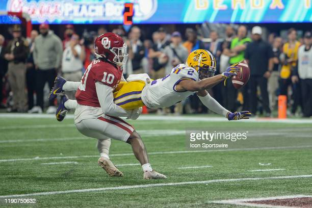 LSU wide receiver Justin Jefferson stretches for the goal line and a touchdown during the College Football Playoff Semifinal game between the LSU...