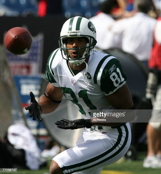 Wide Receiver Justin McCareins of the New York Jets makes a catch during the NFL game against the Buffalo Bills at Ralph Wilson Stadium, Orchard...