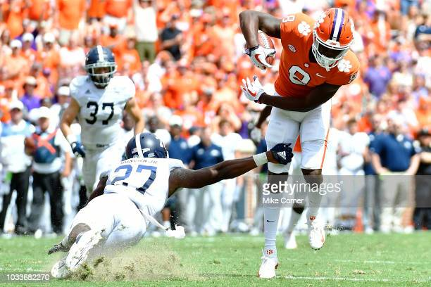 Wide receiver Justyn Ross of the Clemson Tigers makes safety Kenderick Duncan Jr #27 of the Georgia Southern Eagles miss on a tackle as he runs in a...