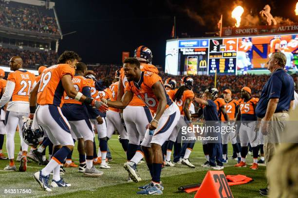 Wide receiver Kalif Raymond of the Denver Broncos celebrates with Bennie Fowler after a score against the Arizona Cardinals during a preseason NFL...