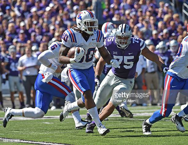 Wide receiver Kam McKnight of the Louisiana Tech Bulldogs rushes to the outside against defensive end Jordan Willis of the Kansas State Wildcats...