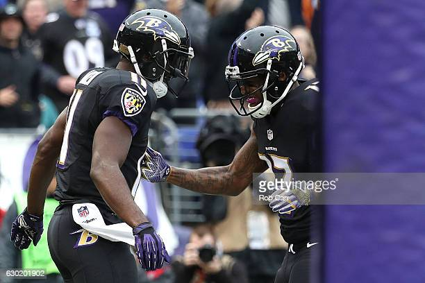 Wide receiver Kamar Aiken of the Baltimore Ravens celebrates with teammate wide receiver Mike Wallace of the Baltimore Ravens after scoring a first...