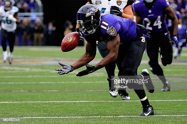 Wide receiver Kamar Aiken of the Baltimore Ravens recovers a blocked punt for a touchdown in the first quarter of a game against the Jacksonville...