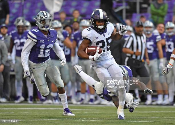 Wide receiver KaVontae Turgin of the TCU Horned Frogs runs up field against the Kansas State Wildcats during the second half on October 14 2017 at...