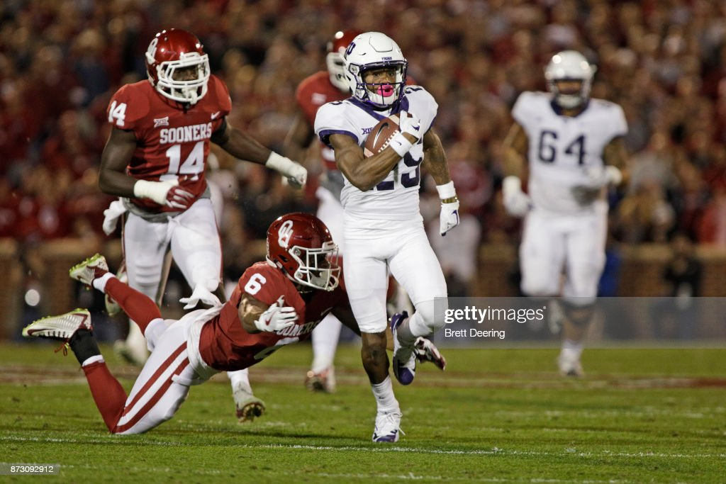 Wide receiver KaVontae Turpin #25 of the TCU Horned Frogs runs downfield against the Oklahoma Sooners at Gaylord Family Oklahoma Memorial Stadium on November 11, 2017 in Norman, Oklahoma. Oklahoma defeated TCU