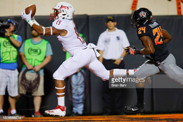Wide receiver Kawaan Baker of the South Alabama Jaguars pulls down a touchdown against safety Jarrick Bernard of the Oklahoma State Cowboys in the...