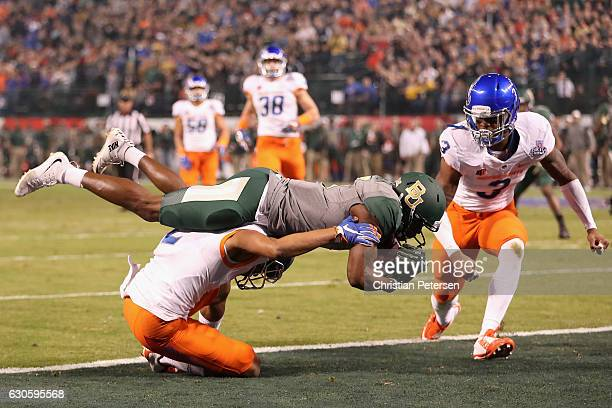 Wide receiver KD Cannon of the Baylor Bears reacts after scoring on a 30 yard touchdown reception over safety Davion Hall of the Baylor Bears during...