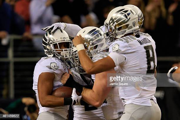 Wide receiver Keanon Lowe of the Oregon Ducks celebrates after catching a 7 yard touchdown thrown by quarterback Marcus Mariota in the first quarter...