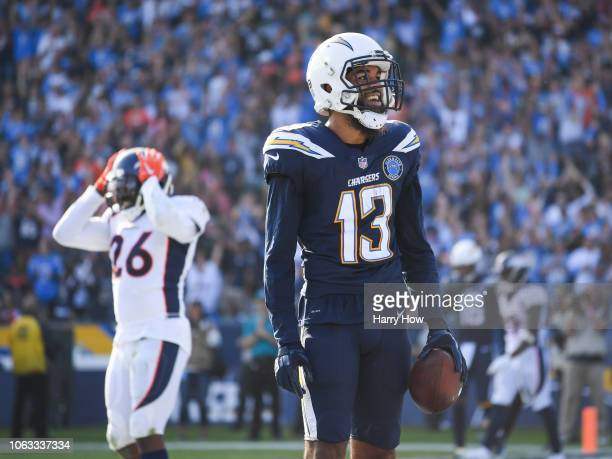 Wide receiver Keenan Allen of the Los Angeles Chargers celebrates his touchdown catch in front of strong safety Darian Stewart of the Denver Broncos...