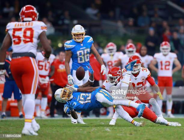 Wide receiver Keenan Allen of the Los Angeles Chargers has the pass broken up by cornerback Charvarius Ward of the Kansas City Chiefs during the game...