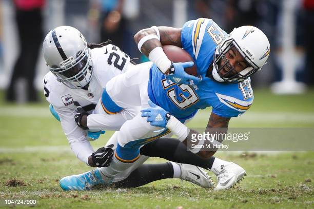Wide receiver Keenan Allen of the Los Angeles Chargers is tackled by free safety Reggie Nelson of the Oakland Raiders in the second quarter at...
