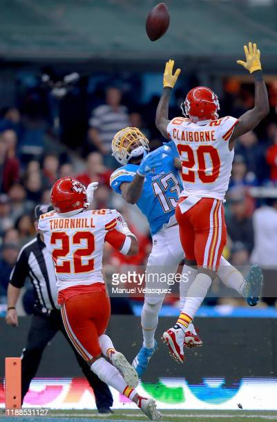 Wide receiver Keenan Allen of the Los Angeles Chargers leaps for the ball over the defense of cornerback Morris Claiborne and free safety Juan...