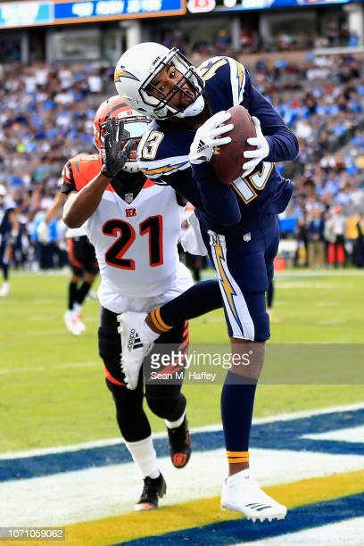 Wide receiver Keenan Allen of the Los Angeles Chargers makes a catch in front of defensive back Darqueze Dennard of the Cincinnati Bengals for a...