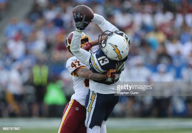 Wide receiver Keenan Allen of the Los Angeles Chargers makes a catch in the second quarter over cornerback Quinton Dunbar of the Washington Redskins...