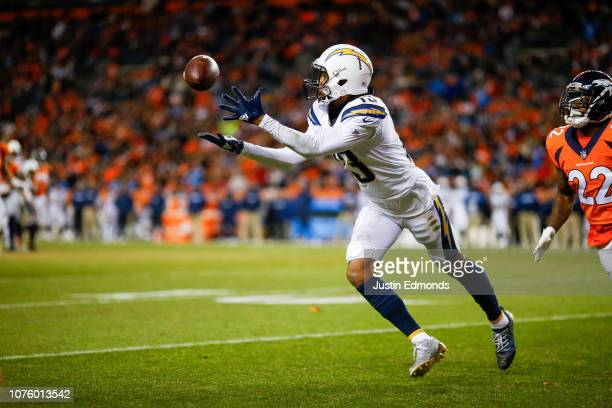 Wide receiver Keenan Allen of the Los Angeles Chargers reaches for a pass against the Denver Broncos in the fourth quarter of a game at Broncos...