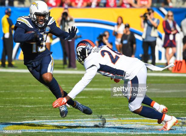 Wide receiver Keenan Allen of the Los Angeles Chargers runs the ball after a complete pass in front of strong safety Darian Stewart of the Denver...