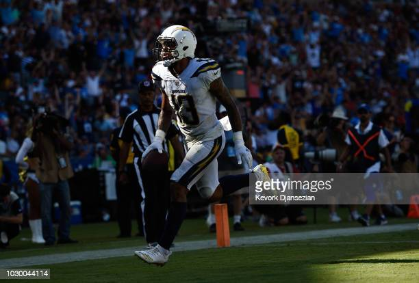 Wide receiver Keenan Allen of the Los Angeles Chargers scores a touchdown in the fourth quarter against the Kansas City Chiefs at StubHub Center on...