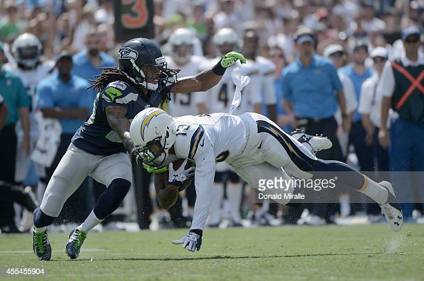 Wide receiver Keenan Allen of the San Diego Chargers catches a pass while defended by cornerback Richard Sherman of the Seattle Seahawks at Qualcomm...