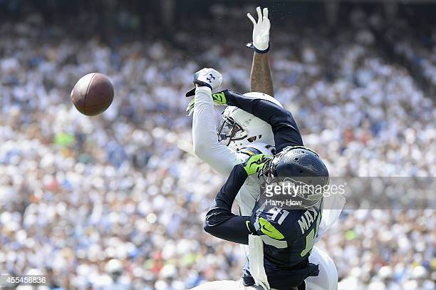 Wide receiver Keenan Allen of the San Diego Chargers is defended by cornerback Byron Maxwell of the Seattle Seahawks at Qualcomm Stadium on September...