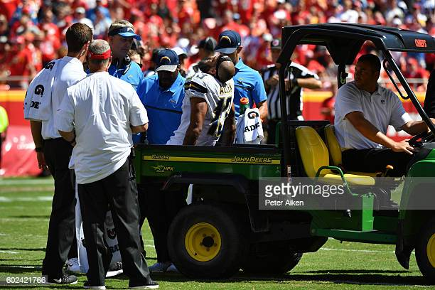 Wide receiver Keenan Allen of the San Diego Chargers is loaded on to a cart after being injured on a play during the third quarter of the game agains...