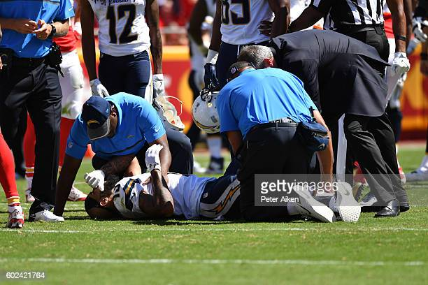 Wide receiver Keenan Allen of the San Diego Chargers lays on the field and is attended to by the Chargers medical staff after being injured on a play...