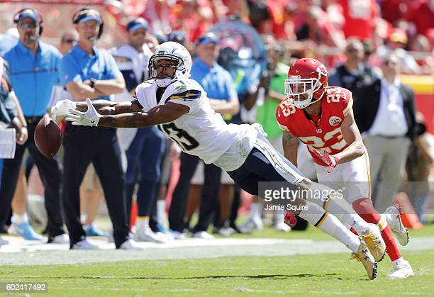 Wide receiver Keenan Allen of the San Diego Chargers stretches for the ball as defensive back Phillip Gaines of the Kansas City Chiefs defends during...
