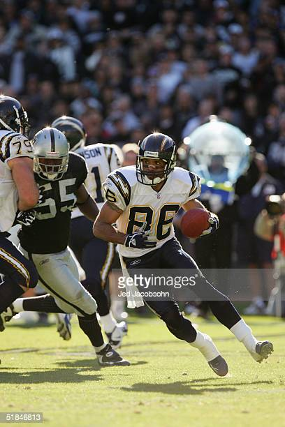 Wide receiver Keenan McCardell of the San Diego Chargers carries the ball during the game against the Oakland Raiders at Network Associates Coliseum...
