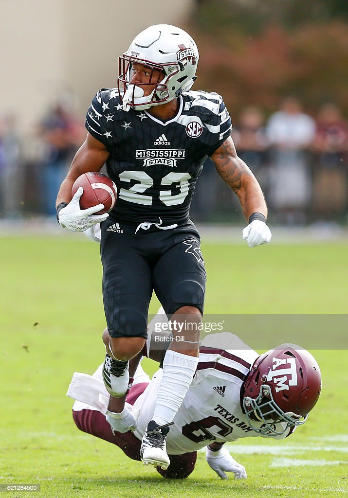 Wide receiver Keith Mixon #23 of the Mississippi State Bulldogs escapes the would be tackle of defensive back Donovan Wilson #6 of the Texas A&M Aggies during the second half of an NCAA college football game at Davis Wade Stadium on November 5, 2016 in Starkville, Mississippi.