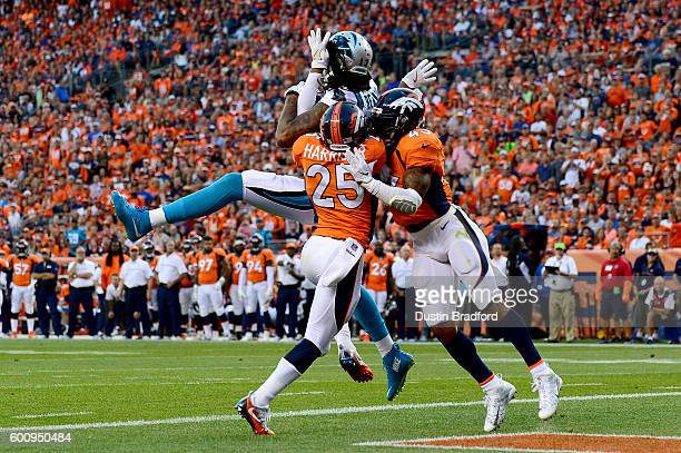 Wide receiver Kelvin Benjamin of the Carolina Panthers catches a 14yard touchdown reception in the first quarter against strong safety TJ Ward and...